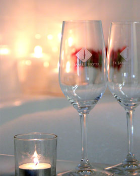Escape to the St. James Hotel with two champagne glasses